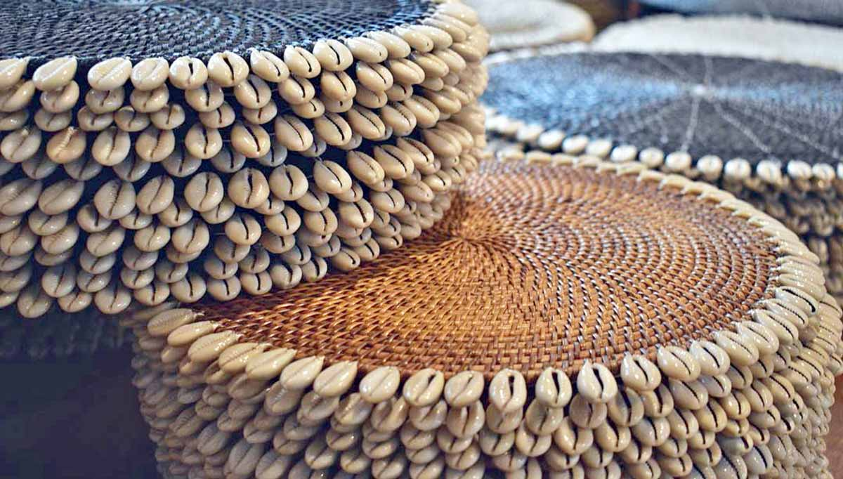 Natural rattan placemats with cowrie shell edge detail
